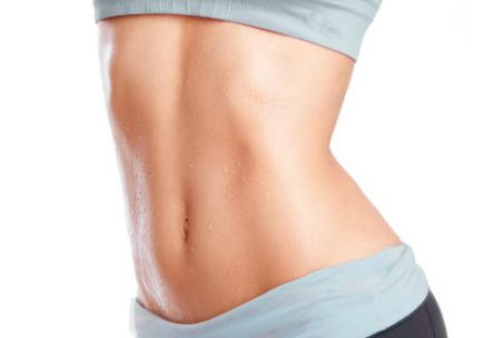 Photo: Woman's toned stomach in fitness clothes