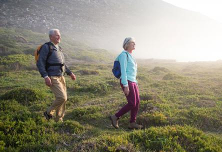 Photo: Couple hiking outdoors.
