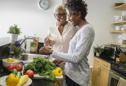 Women in kitchen with Vegetables