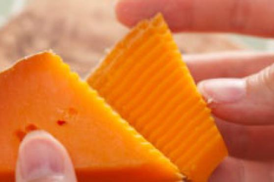 Photo: Wedge of orange cheese