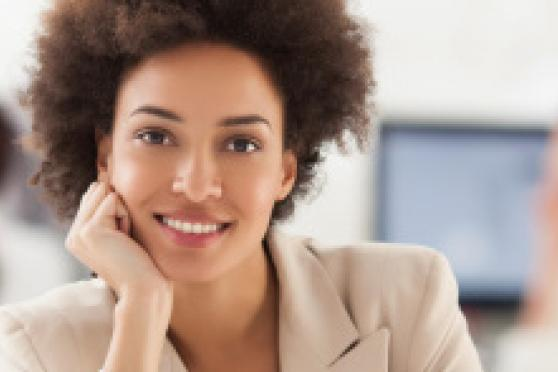 Photo: Smiling woman in office setting