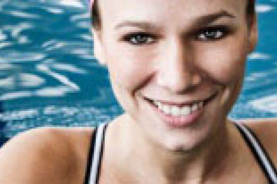Photo: Smiling woman in swimming pool