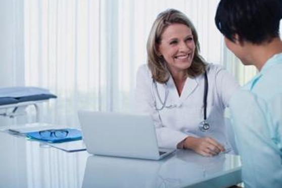 Photo: Doctor consulting with her female patient