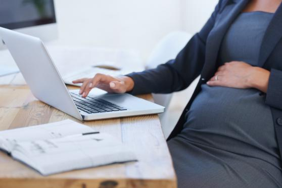 Pregnant mom working from desk