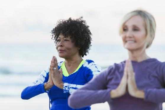 older women doing yoga