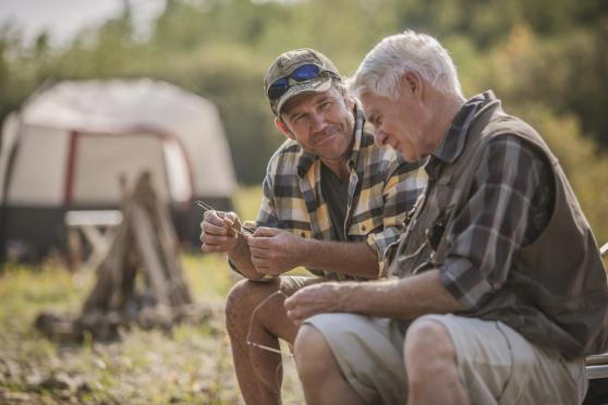 Photo: two men at a campground