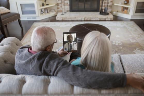 older couple face timing with doctor