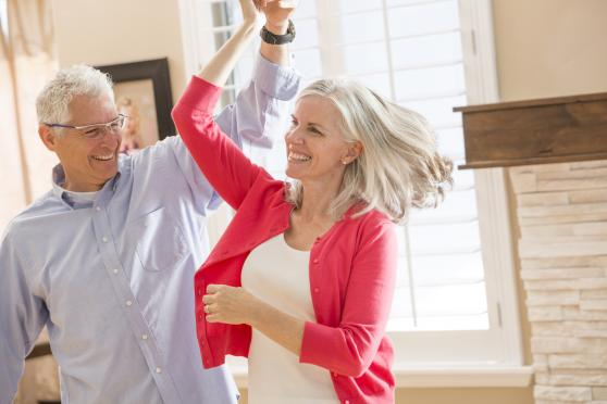 Photo: Mature couple smiling and dancing