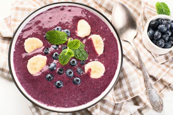 Photo: Blueberry Smoothie Bowl with spoon and small bowl of additional blueberries.