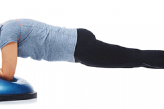 Woman planking on BOSU ball