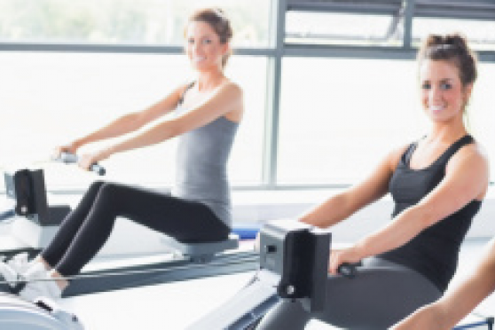 Photo: 3 women on rowing machines in a gym